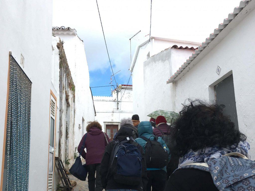 women-going-up-white-village