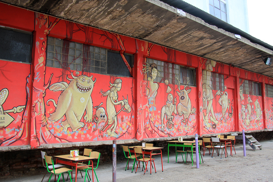 red wall with drawing of figures