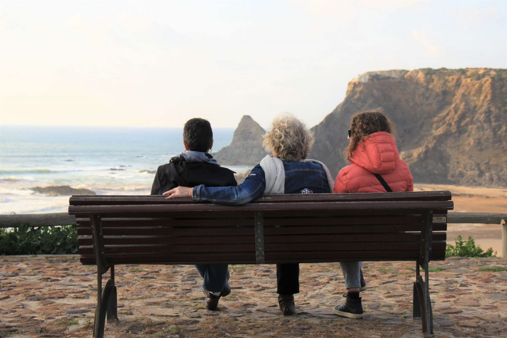 women seating watching the sea